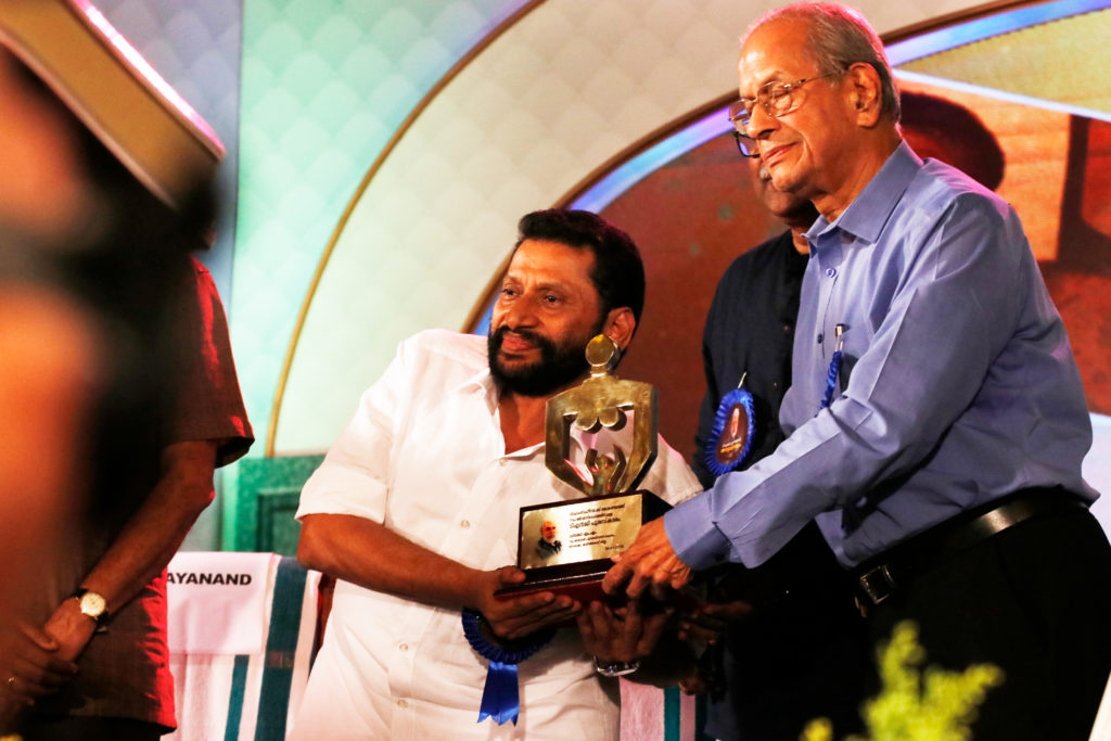 Receiving award from E. Sreedharan